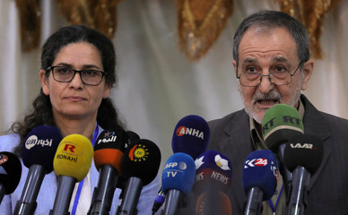Ilham Ahmed and Riad Darar co-chair's of the Syrian Democratic Council (SDC) are seen during the third meeting in Tabqa