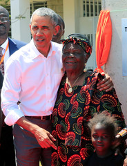 Former U.S. President Barack Obama embrace his grandmother Sarah Obama at the Sauti Kuu resource centre near his ancestral home in Nyangoma Kogelo village in Siaya county