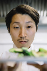 Japanese cook with food plate