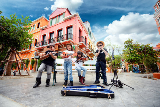 kids playing street musics song on the city walking street for donate, endow, contribute and dole in holidays hobby occasion
