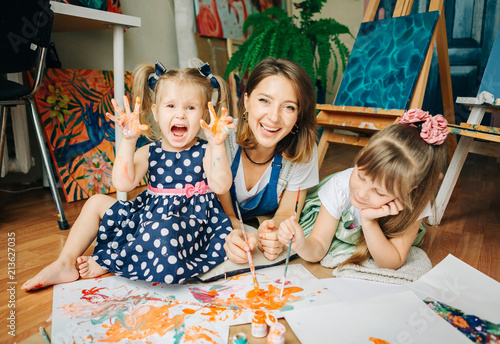 Happy mom and her child playing with finger paint . Games with ...
