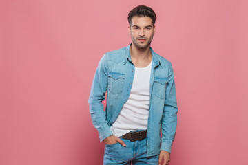 relaxed man wearing denim shirt and jeans standing