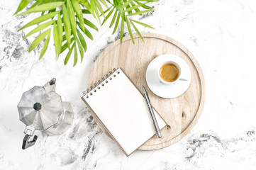 Home office workplace notebook coffee green tropical plant