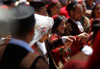 People dressed in folk costumes take part in a traditional wedding ceremony in the village of Galicnik