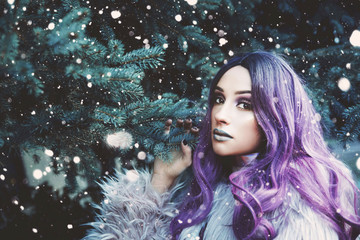 Young woman with violet hair winter portrait