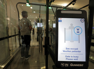 A passenger enters an airlock for facial recognition at Nice international airport's immigration section in Nice