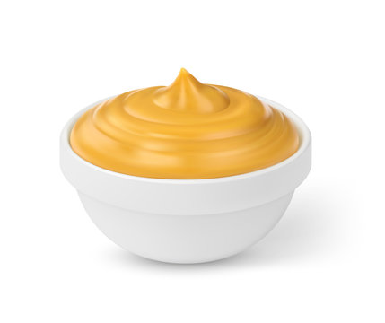 Mustard sauce in bowl isolated on white background