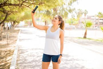 Runner taking selfie at park