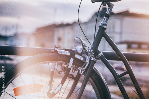 Detail of a black retro bicycle on a city background, image with