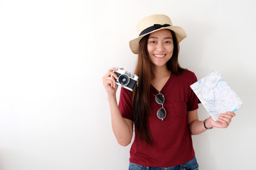 Young asian woman traveler holding vintage camera and map with copy space, people summer holiday vacation background concept