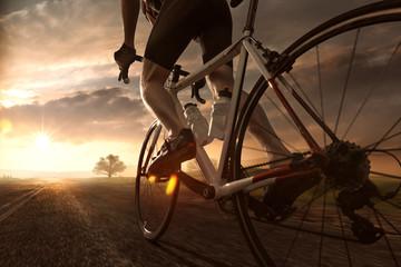 Photo on textile frame Cycling Mann auf Rennrad im Sonnenuntergang