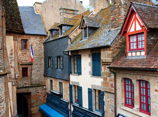 France. Normandy. A view from above of the ancient houses of the Abbey of Mont Saint Michel on a summer day.