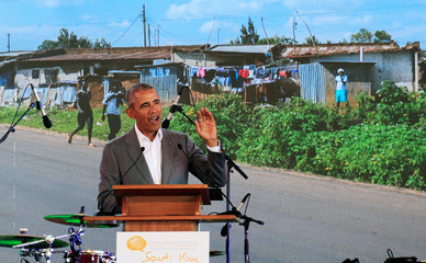 Former U.S. President Barack Obama addresses delegates during the launch of Sauti Kuu resource centre near his ancestral home in Nyangoma Kogelo village in Siaya county