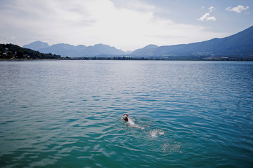 A man swims into the Bourget Lake in Tresserve