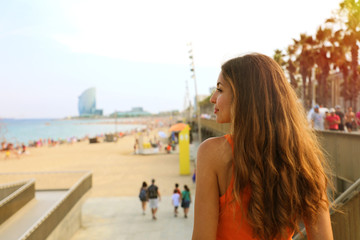 Happy city woman go to the beach at sunset. Lifestyle concept.