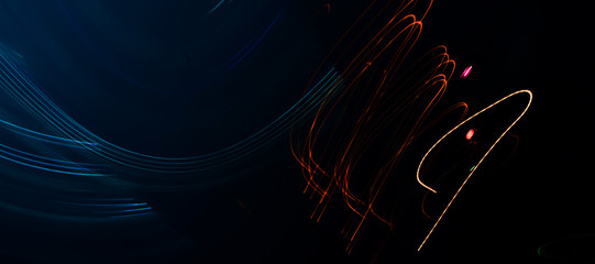 Abstract background of long explosure tale light on black ,Technology backgroud