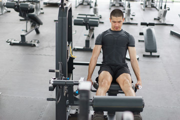 Asian man exercising in the gym,