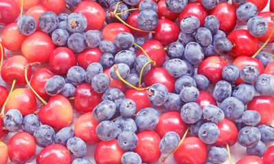 fresh berry - red and yellow cherry and blueberries, background