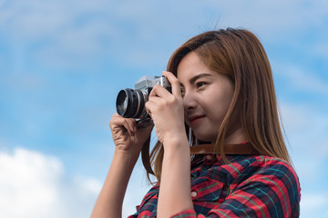 Young hipster Asian woman taken a photo.
