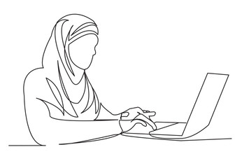 Muslim woman at work on the computer03