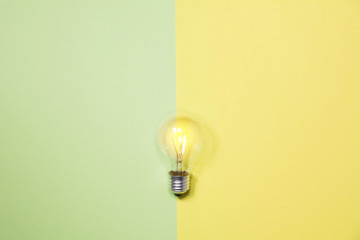 Top view of light bulb on colorful background and copy space for insert text.
