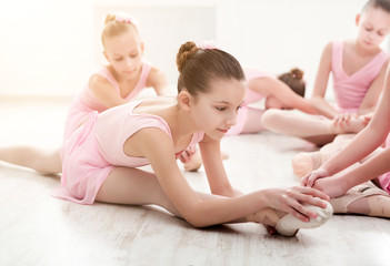 Little ballerinas in ballet studio