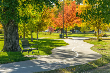 Autumn City Park - A sunny autumn afternoon view of a quiet running trail winding in a city park, Denver/Lakewood, Colorado, USA.