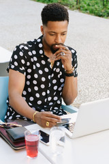 Bearded man holding a credit card