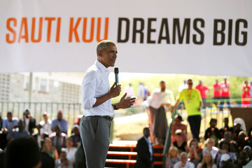 Former U.S. President Barack Obama addresses delegates at the basketball court during the launch of Sauti Kuu resource centre near his ancestral home in Nyangoma Kogelo village in Siaya county