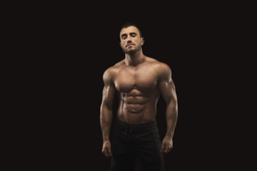Strong athletic man with naked muscular body Wall mural