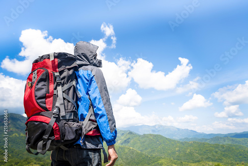 54a0508f7e30 Traveler Man climbing with backpack Travel Lifestyle concept active adventure  summer vacations hiking outdoor mountains landscape on background