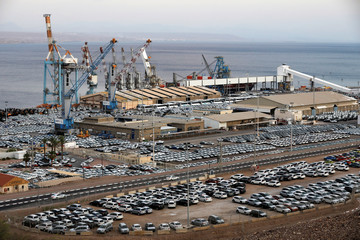 New imported cars are seen in a parking lot next to the Eilat port