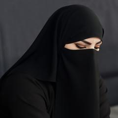 Muslim woman in niqab. Qatar