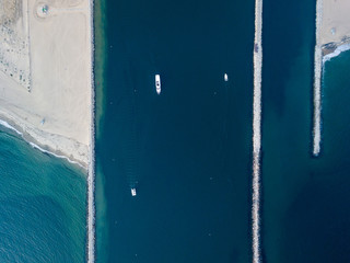 Beach And Jetties On A Blue Ocean