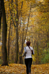Photo from back in full growth of woman running forest