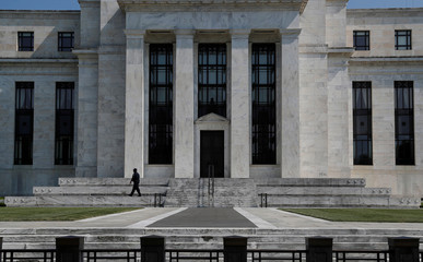 Security guard patrols the Federal Reserve building in Washington