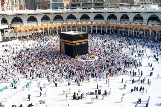 MECCA, SAUDI ARABIA - MAY 02 2018: People walking around Holy Kaaba seven circles in Masjid Al Haram or Grand Mosque of Makkah, making Tawaf. Amazing shots from the top roof floor of the mosque