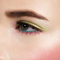 Beautiful blue eyes with bright creative cosmetics. Long eyebrows and dense eyelashes create the fashionable image. Evening cosmetics, cosmetics, cosmetology