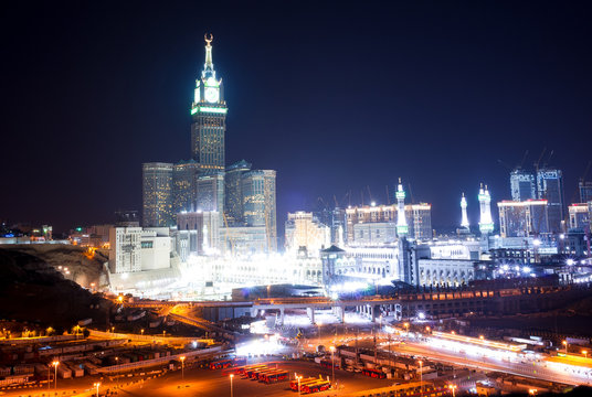 MECCA, SAUDI ARABIA - MAY 05 2018: Amazing night long exposure view on Abraj Al Bait or Clock Tower and Masjid Al Haram mosque in Mecca. Panoramic view on the entire city center from a hill