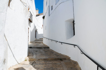 Stone pavement stairs going up on narrow street in Vejer white town, Spain. Guided tour, tourist attraction, summer holidays, travel destination concepts