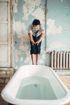 Businessman in flippers dives into the bathtub