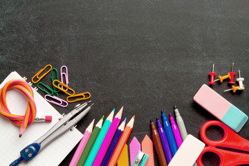 School supplies on blackboard background . The concept of education, study, learning, elearning. Back to school
