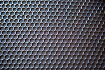 Background image with a three-dimensional hexagonal texture.