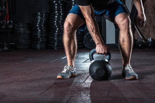 crossfit kettlebell training in gym.