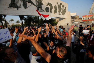 Iraqis shout slogans during a protest in Baghdad