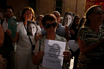 People attend a vigil and demonstration marking nine months since the assassination of journalist Daphne Caruana Galizia in a car bomb, in Valletta