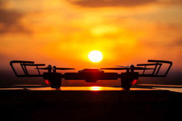 drone drone on a sunset background stands on a table