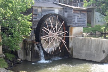 The water wheel on the old building.