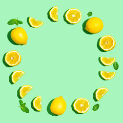 Fresh lemon circle on a pastel green background flat lay