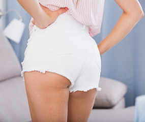 Female buttocks in white shorts